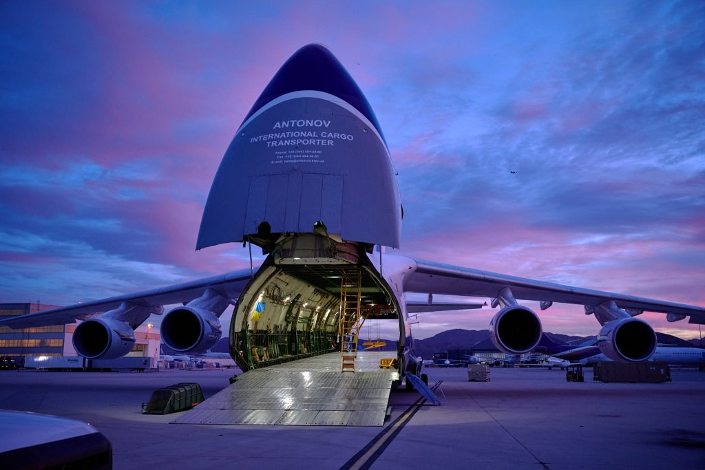 Antonov aircraft unloading cargo on the ramp at sunset at SBD airport